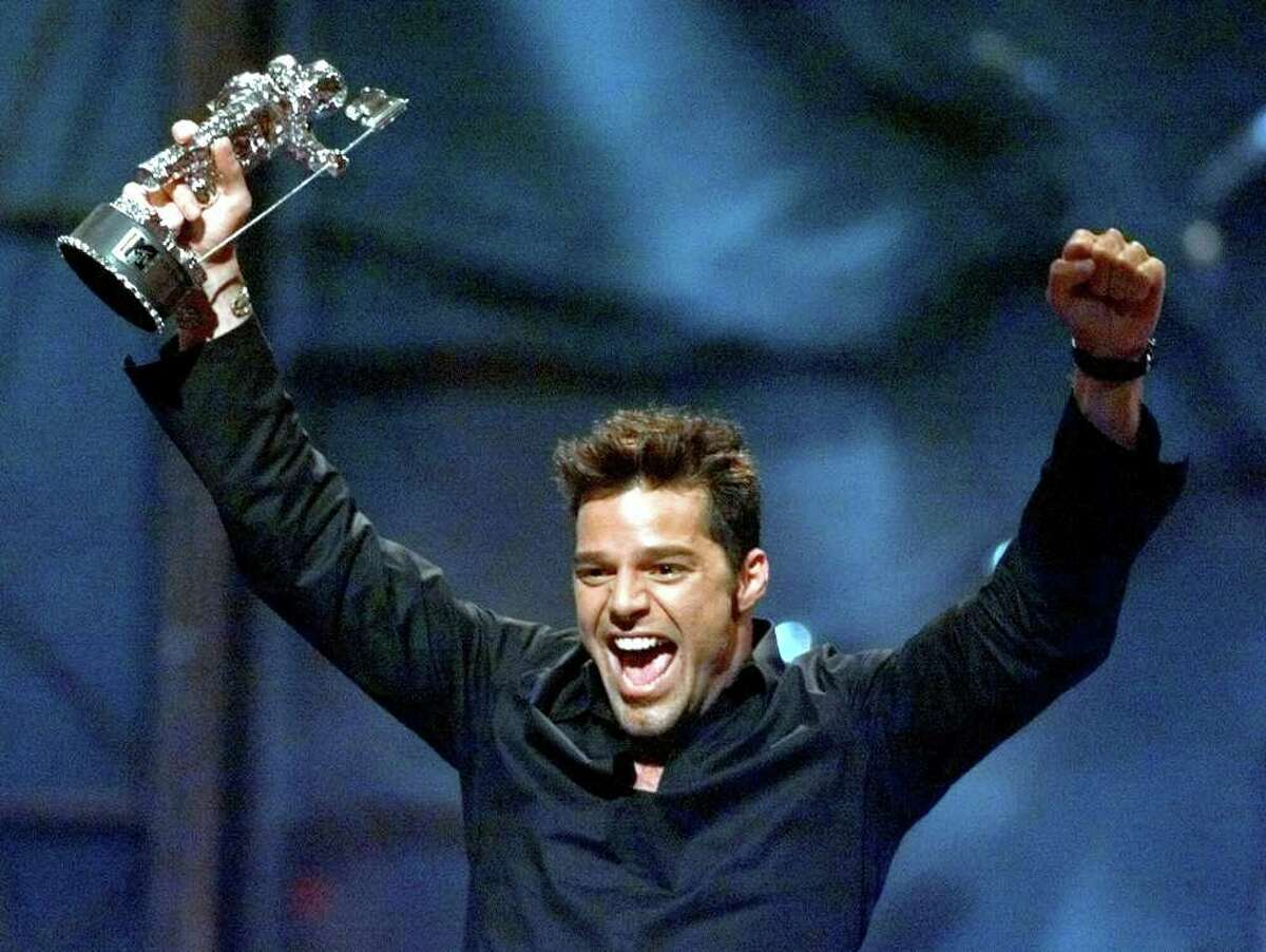 Latin superstar Ricky Martin reacts after winning in the best dance video category for his song