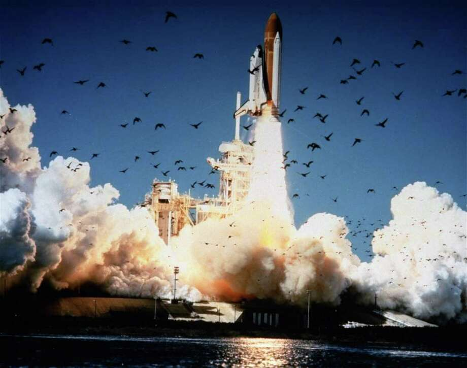 FILE - In this Jan. 28, 1986 file photo, the space shuttle Challenger lifts off Pad 39B at Kennedy Space Center, Florida.  A whole generation _ including McAuliffe's own students _ has grown up since McAuliffe and six other astronauts perished on live TV on Jan. 28, 1986, a quarter century ago on Friday, Jan. 28, 2011. Now the former schoolchildren who loved her are making sure that people who weren't even born then know about McAuliffe and her dream of going into space. (AP Photo/NASA) Photo: Anonymous, AP / AP1986