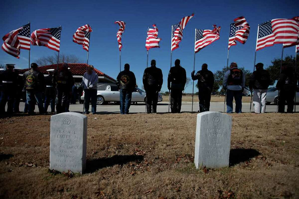 Patriot Guard Riders members line up with flags in honor of fallen Marine Sgt. Wesley James Rice at Fort Sam Houston National Cemetery on Thursday, Jan. 27, 2011. Rice, 27, was an Iraq War veteran and a native of San Antonio.