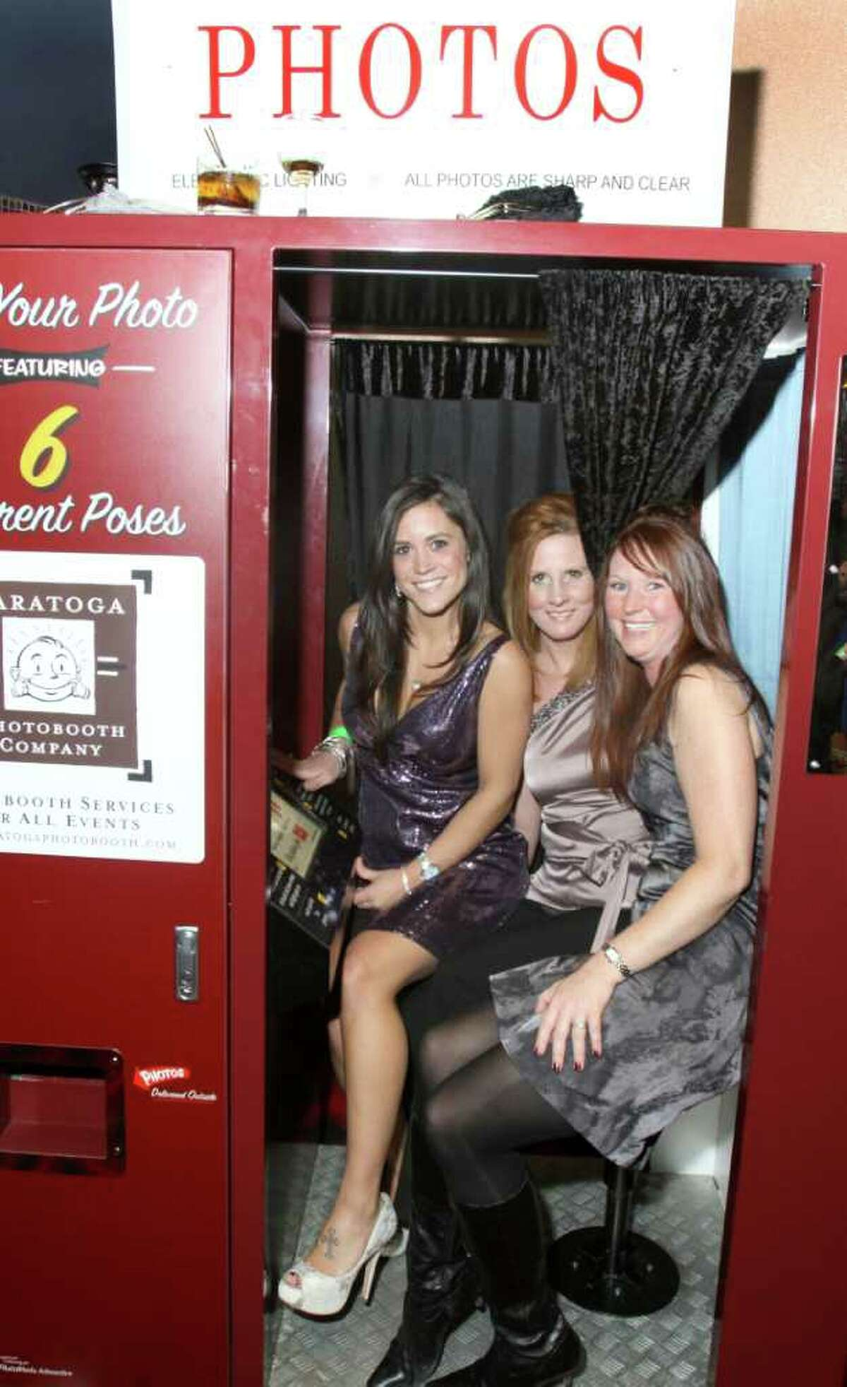From left: Jennifer Fortune Gras, Melissa Murdock and Michele Auman share the photo booth Jan. 21, 2011 at Vapor Nightclub at the Saratoga Gaming and Raceway during