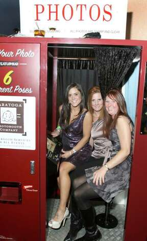 "From left: Jennifer Fortune Gras, Melissa Murdock and Michele Auman share the photo booth Jan. 21, 2011 at Vapor Nightclub at the Saratoga Gaming and Raceway during ""Diamonds in the Rough,"" a fundraiser to benefit Girl Inc. Cornerstone Group. (Joe Putrock / Special to the Times Union) Photo: Joe Putrock / Joe Putrock"