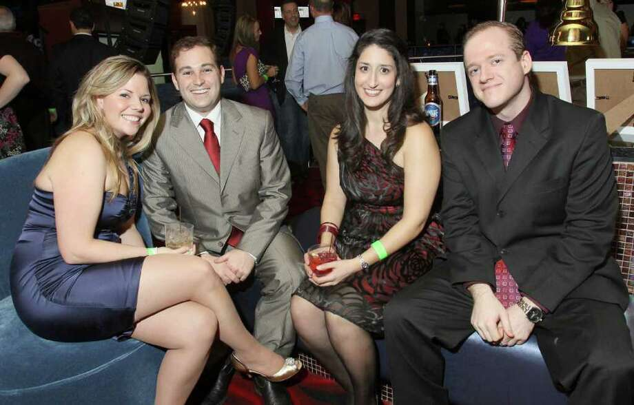 "From left: Elizabeth and Justin Lurie, Namita Chatterjee and Don Matthews Jan. 21, 2011 at Vapor Nightclub at the Saratoga Gaming and Raceway during ""Diamonds in the Rough,"" a fundraiser to benefit Girl Inc. Cornerstone Group. (Joe Putrock / Special to the Times Union) Photo: Joe Putrock / Joe Putrock"