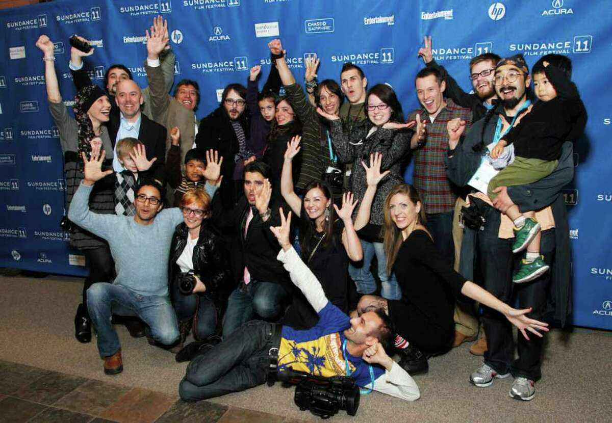 Contributing filmmakers from all around the world pose together at the premiere of the feature-length documentary