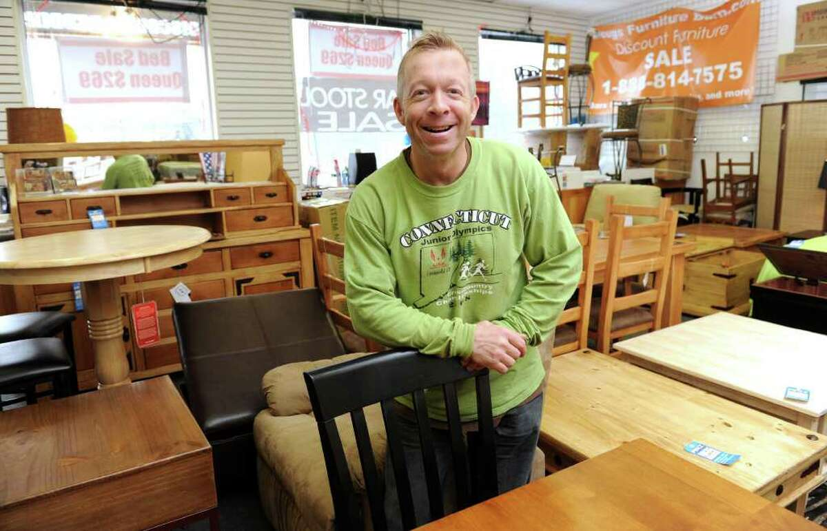 Doug Hughes, 47, of New Fairfield, is the owner of Dougs Furniture Barn.com at 115 Federal Road in Brookfield. Photo taken Friday, January 28, 2011.