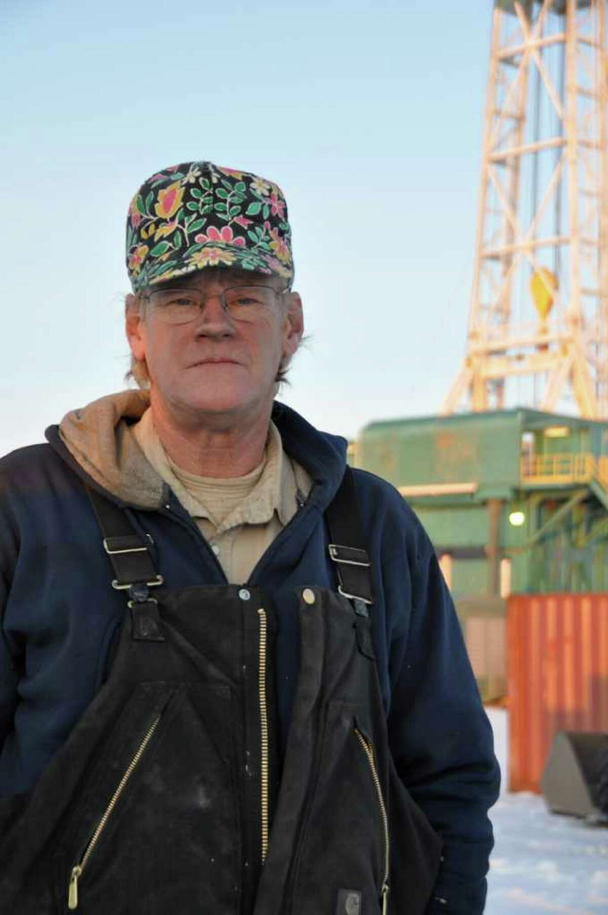 In this undated publicity image released by Planet Green, Larry Walsh, an oil rig worker, is shown at a drilling site in Parshall, N.D. Planet Green's