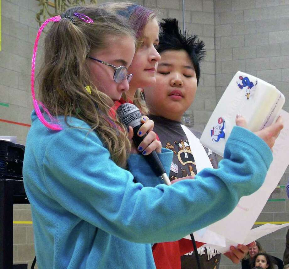 From left, Jamie Ginnetti, Clara Everett and Andes Ohn, all in the fifth grade at Sherman School, announce a fundraising drive to help the Fairfield Police Department get a dog. Photo: Genevieve Reilly / Fairfield Citizen