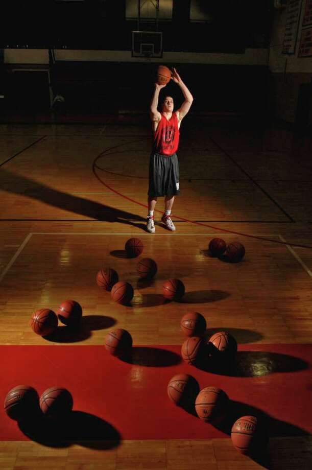 Glens Falls High School's Jimmer Fredette practices free throws on Jan. 4, 2007. Photo: PHILIP KAMRASS / ALBANY TIMES UNION