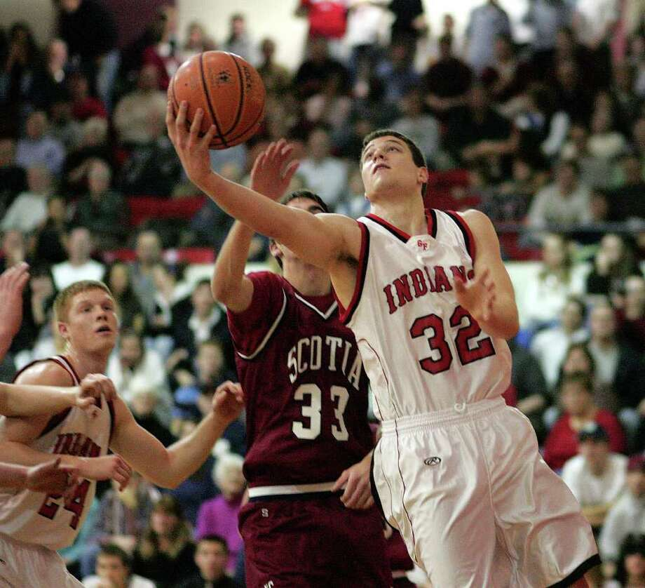 Glens Falls' Jimmer Fredette drives to the basket against Scotia-Glenville on Jan. 5, 2007. Photo: Jeff Foley / ALBANY TIMES UNION