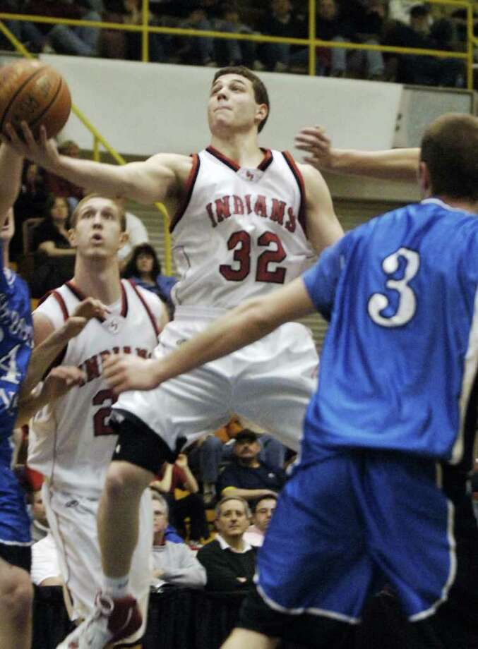 Glens Falls' Jimmer Fredette makes his move to the basket against Ichabod Crane on March 3, 2007. Photo: JAMES GOOLSBY / ALBANY TIMES UNION