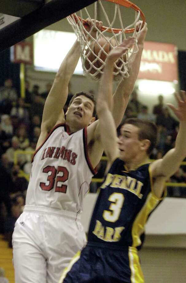 Glens Falls'  Jimmer Fredette dunks during a game against Averill Park on March 6, 2007. Photo: JAMES GOOLSBY / ALBANY TIMES UNION