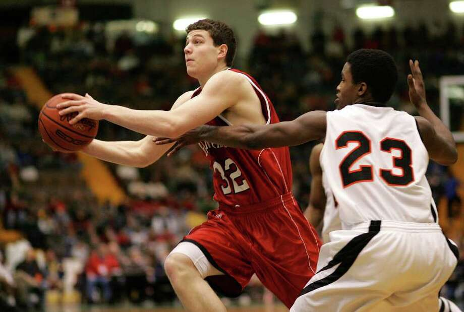 Jimmer Fredette of Glens Falls drives past McKinley's Tamere Shannon on March 17, 2007. Photo: Jeff Foley / ALBANY TIMES UNION