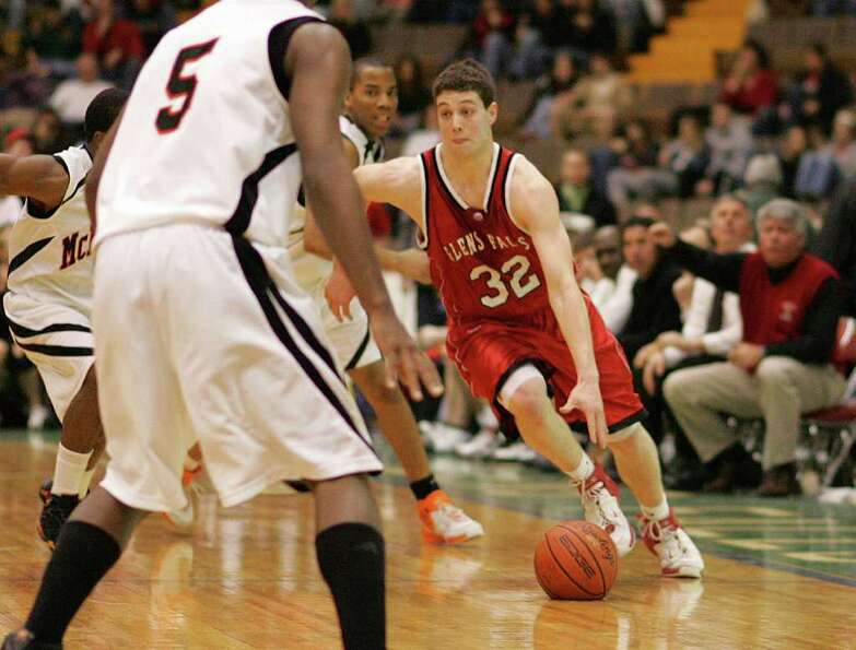 The ball takes on an odd shapes as Glens Falls' Jimmer Fredette dribbles up the court against McKinl