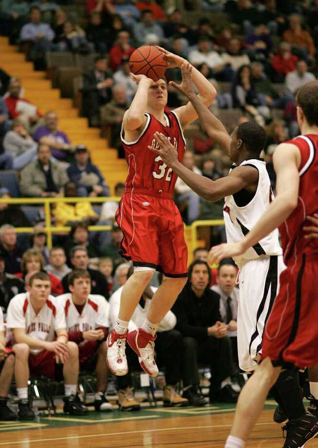 Glens Falls' Jimmer Fredette attempts a three-pointer against McKinley on March 17, 2007. Glens Falls defeated McKinley, 72-54, and Fredette broke the Section II scoring record. Photo: Jeff Foley / ALBANY TIMES UNION