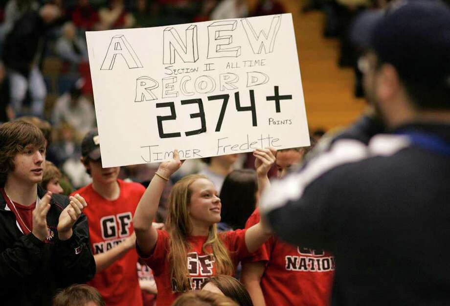 Glens Falls fan Alicia Flewelling holds up a sign celebrating the Section II scoring record set by Glens Falls' Jimmer Fredette against McKinley on March 17, 2007. Photo: Jeff Foley / ALBANY TIMES UNION
