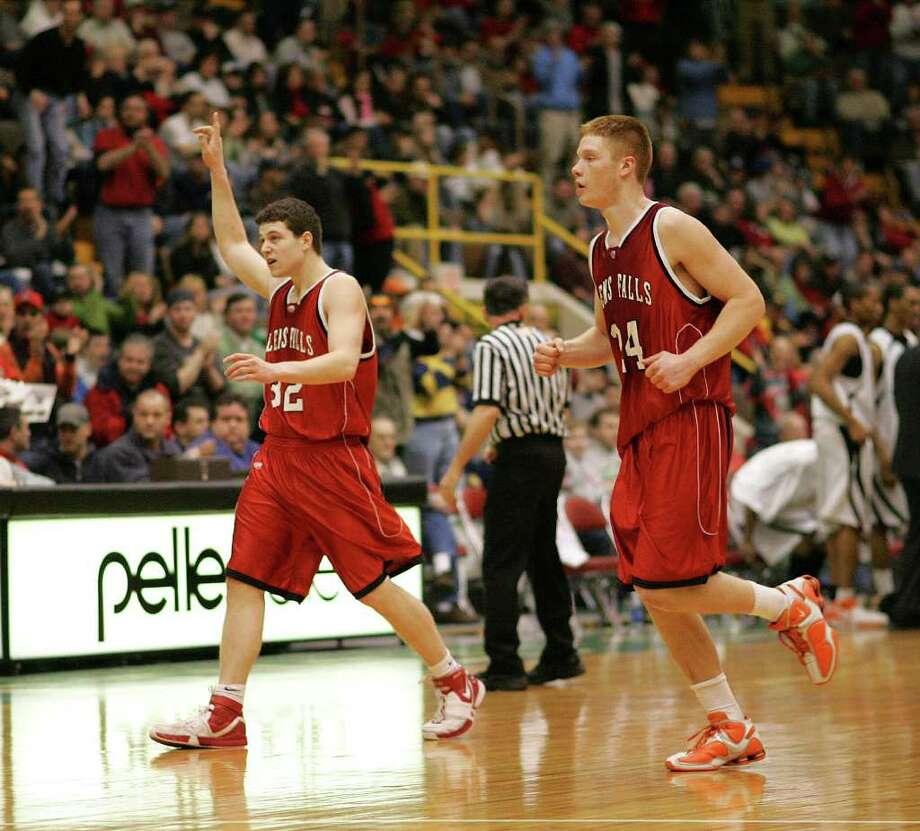 Glens Falls' Jimmer Fredette acknowledges the crowd as he and teammate Denny Wilhelm come off the floor during a timeout against McKinley on March 17, 2007. Photo: Jeff Foley / ALBANY TIMES UNION