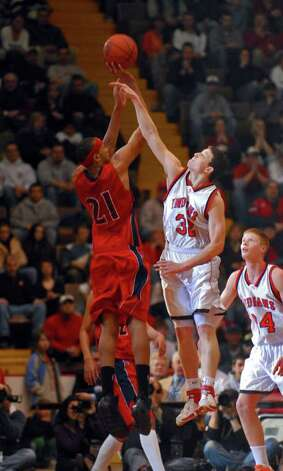 Glens Falls' Jimmer Fredette defends Peekskill's Mookie Jones (now at Syracuse) during the Class A final on March 18, 2007. Photo: PHILIP KAMRASS / ALBANY TIMES UNION