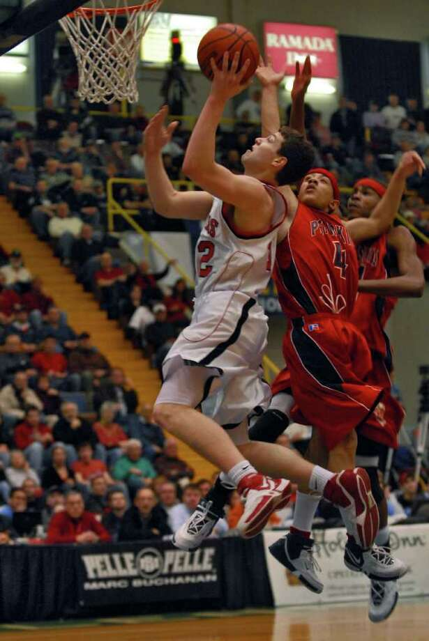 Glens Falls' Jimmer Fredette shoots against Peekskill during the Class A state final on March 18, 2007. Photo: PHILIP KAMRASS / ALBANY TIMES UNION