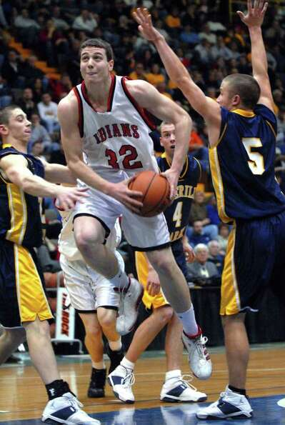 Glens Falls' Jimmer Fredette drives the lane against the Averill Park defense on March 6, 2006.