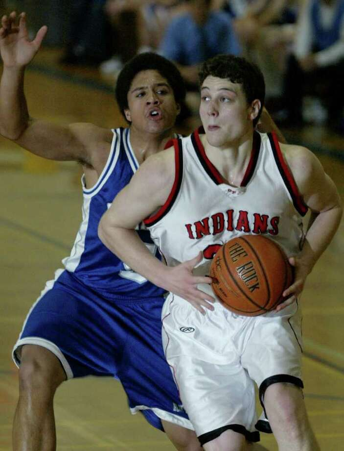 Glens Falls' senior Jimmer Fredette drives the lane against Saratoga's Ryan James on Dec. 28, 2006. Photo: Jon Winslow