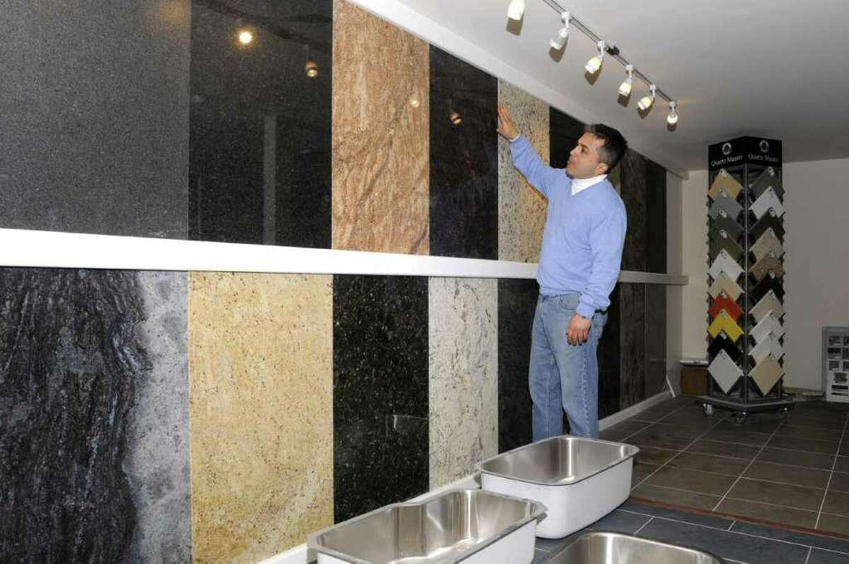 Sinan Sepkin, owner of Academy Marble & Granite, in Bethel, shows samples in his showroom on Wednesday, Jan. 26, 2011.