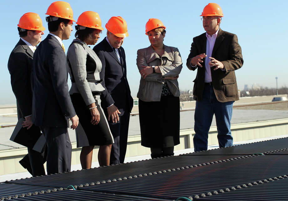 Local officials show EPA Administrator Lisa Jackson (second from right) the solar array on the roof of St. Philip's College. Jackson was in town Friday to attend a green jobs roundtable discussion at the collage. Photo: Jennifer Whitney/Special To The Express-News /  2011 San Antonio Express-News