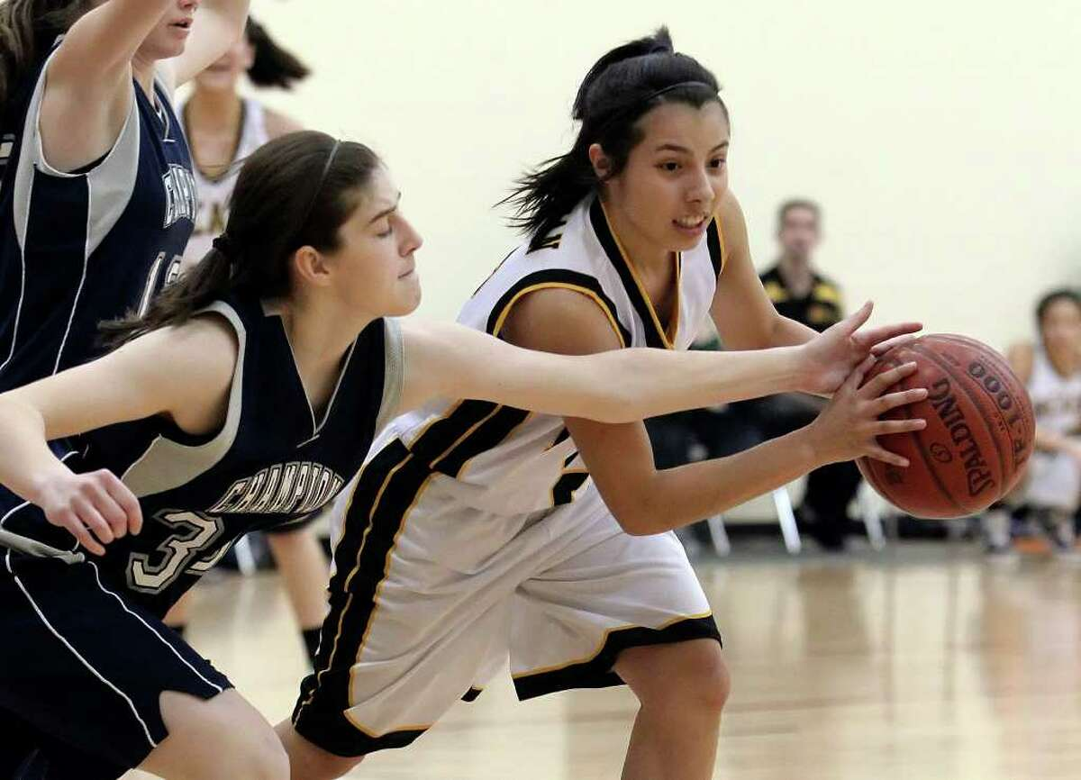 Brennan's Krystan Gomez (right) keeps the ball away from Boerne Champion's Hailey Granstaff (33) in girls basketball at Brennan High School on Friday, Jan. 28, 2011. Brennan defeated Boerne Champion, 51-45. Kin Man Hui/kmhui@express-news.net