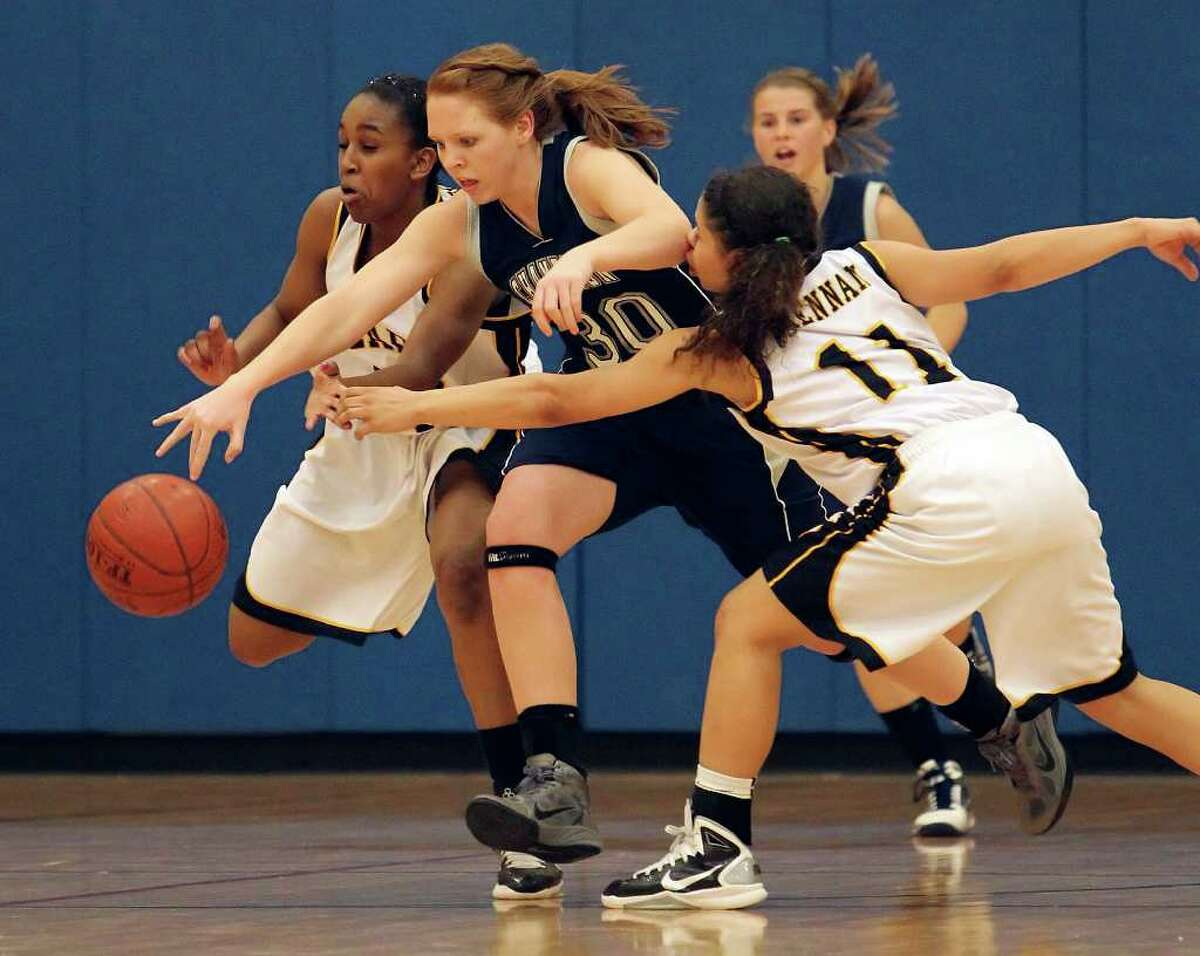 Brennan's Tanaeya Boclair (left) and Alyssa Crockett (11) chases down a loose ball against Boerne Champion's Heather Hormuth (30) in girls basketball at Brennan High School on Friday, Jan. 28, 2011. Brennan defeated Boerne Champion, 51-45. Kin Man Hui/kmhui@express-news.net