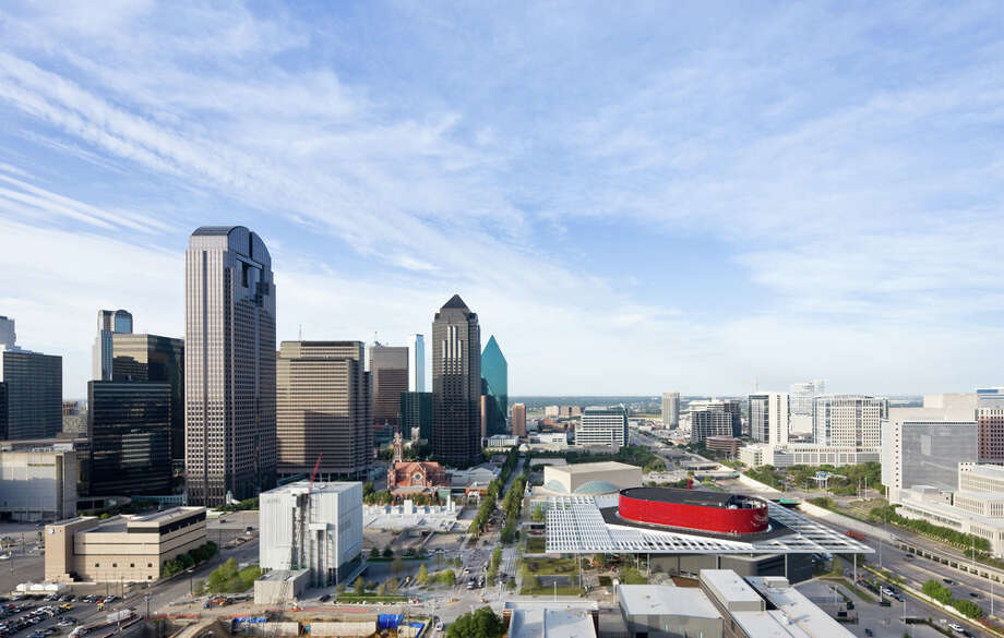 An aerial view of the Dallas Arts District includes the AT&T Performing Arts Center. The red swoosh of a building is the Winspear Opera House within the center. COURTESY IWAN BAAN / bank details:Bank: ABN AMRO Bank NVto: Iwan Baan, AmsterdamAcct.nr.: 512635692IBAN: NL74 ABNA 0512 6356 92BIC/Swift code:
