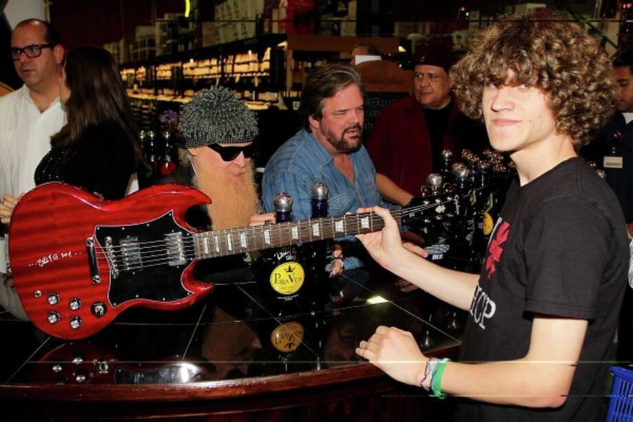 Eric Schmidbauer of San Antonio was among some 1,000 fans that waited for autographs from Billy Gibbons. The legendary ZZ Top guitarist was at Gabriel's Liqour & Wine Superstore on Friday to promote a new brand of tequila, Pura Vida. Photo: Courtesy Of Gibson Guitars