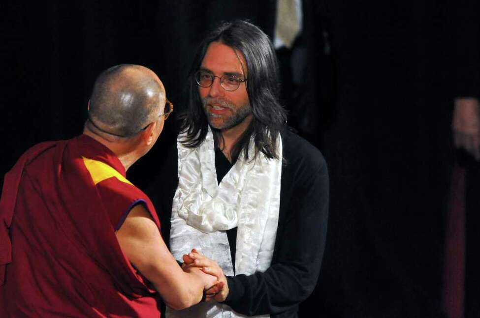 The Dalai Lama speaks onstage in Albany with NXIVM founder Keith Raniere in 2009. (Philip Kamrass / Times Union)