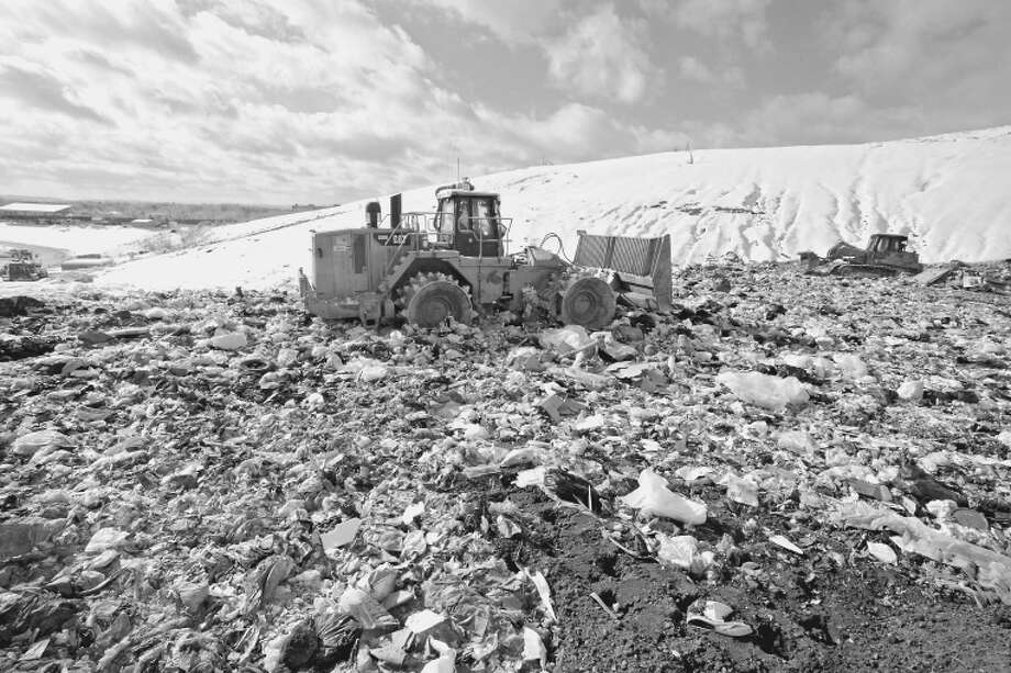 Tractors push trash at the Rapp Road landfill in Albany. The city has reaped millions in benefits from the site, but faces millions in unpaid debt. (Lori Van Buren / Times Union) Photo: Lori Van Buren