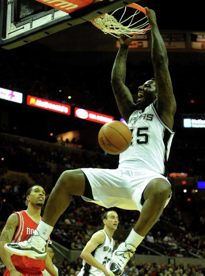 DeJuan Blair of the San Antonio Spurs dunks against the Houston Rockets during NBA action at the AT&T Center on Saturday, Jan. 29, 2011. BILLY CALZADA / gcalzada@express-news.net