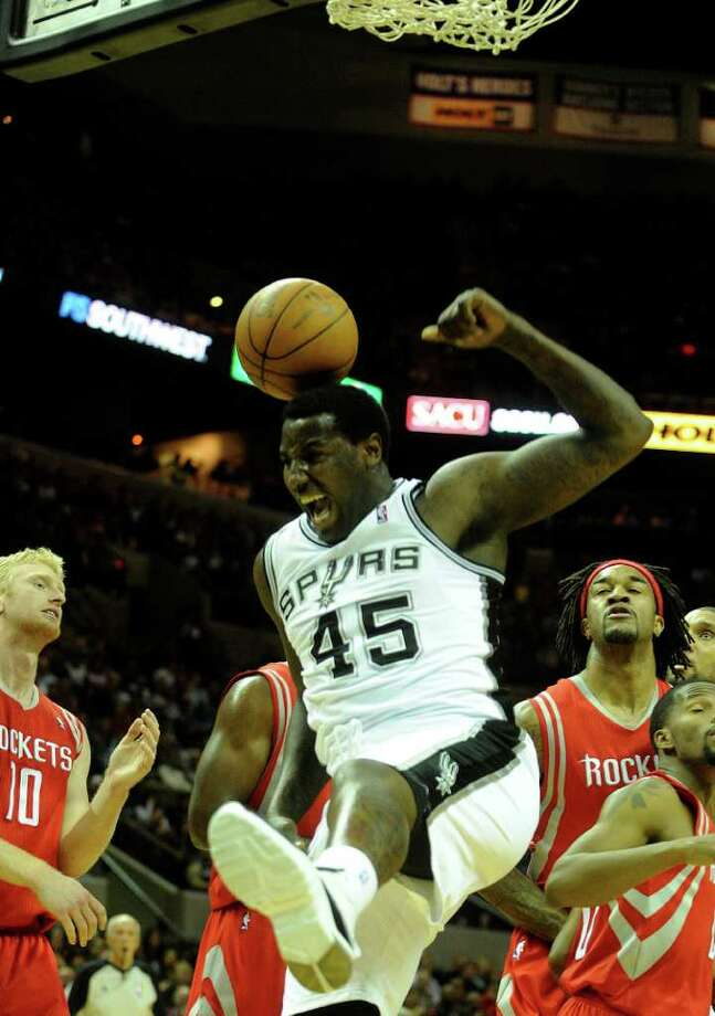 DeJuan Blair of the San Antonio Spurs reacts after scoring on a dunk during NBA action against the Houston Rockets at the AT&T Center on Saturday, Jan. 29, 2011. BILLY CALZADA / gcalzada@express-news.net