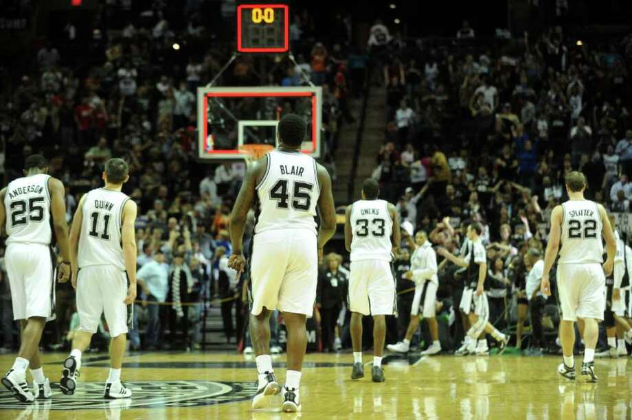 The San Antonio Spurs walk off the court after defeating the Houston Rockets, 108-95, in NBA action at the AT&T Center on Saturday, Jan. 29, 2011. BILLY CALZADA / gcalzada@express-news.net
