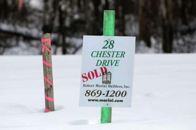 A sold lot sign at the Brookefield Place development in Halfmoon, NY on January 28, 2011. (Lori Van Buren / Times Union) Photo: Lori Van Buren