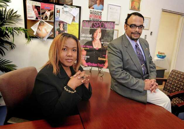 Winsome Alexander and Jason Jinkins provide a local publication that serves as a resource to victims of child abuse. Guiseppe Barranco/The Enterprise Photo: Guiseppe Barranco / Beaumont