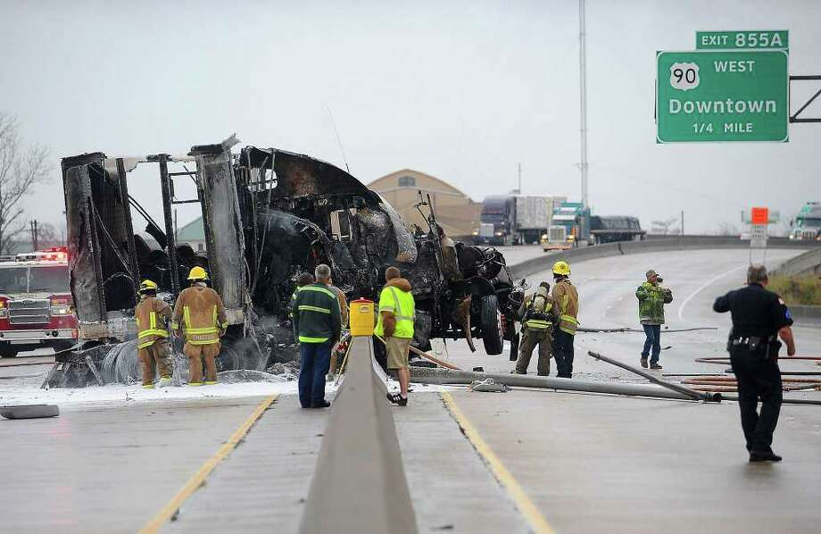 An accident on I-10 involving a major fire in a tractor trailer and a wrecked passenger car closed down both lanes of traffic near the Downtown exit in Beaumont on Sunday morning. No major injuries were reported from the incident. Guiseppe Barranco/The Enterprise / Beaumont