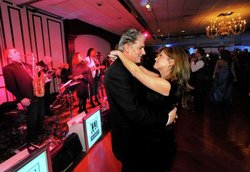 Jim and Stacy Christ, visiting Danbury from Penn. for the 12th Annual Mayor's Ball, dance at the Amber Room Colonnade, Saturday, Jan 29, 2011.
