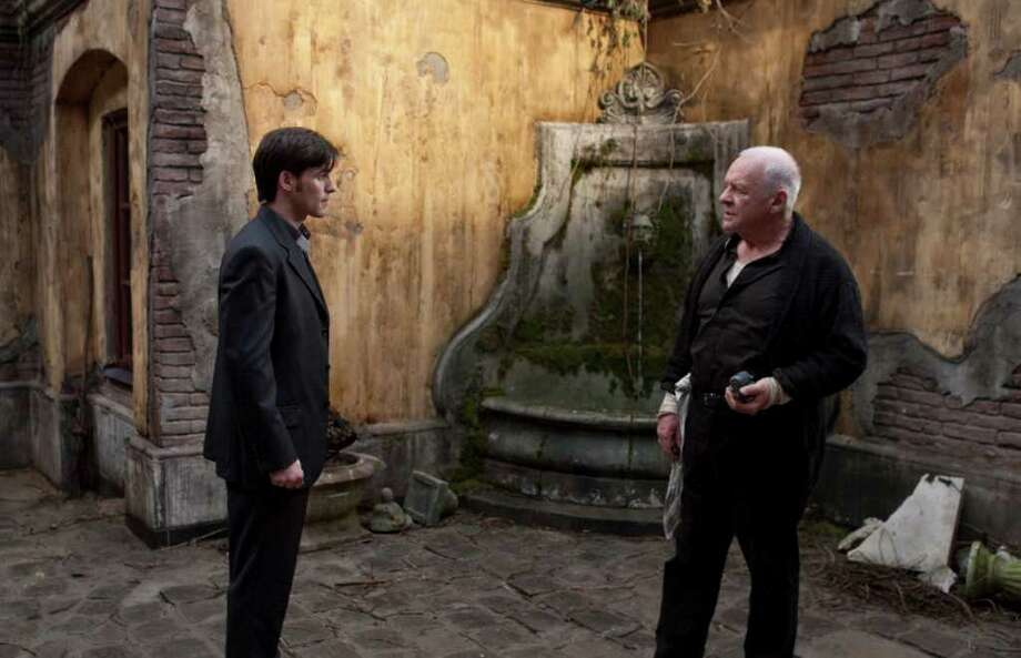 "In this film publicity image released by Warner Bros. Pictures, Colin O'Donoghue, left, and Anthony Hopkins are shown in a scene from ""The Rite."" (AP Photo/New Line Cinema - Warner Bros., Egon Endrenyi) Photo: AP"