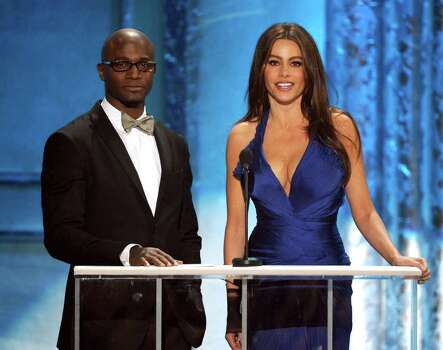 LOS ANGELES, CA - JANUARY 30:  Actors Taye Diggs (L) and Sofia Vergara speak onstage during the 17th Annual Screen Actors Guild Awards held at The Shrine Auditorium on January 30, 2011 in Los Angeles, California.  (Photo by Kevin Winter/Getty Images) *** Local Caption *** Taye Diggs;Sofia Vergara Photo: Kevin Winter, Getty Images / 2011 Getty Images