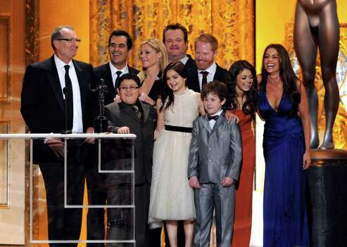 "LOS ANGELES, CA - JANUARY 30:  Cast of ""Modern Family,"" winners of Outstanding Performance by an Ensemble in a Comedy Series award, speak onstage during the 17th Annual Screen Actors Guild Awards held at The Shrine Auditorium on January 30, 2011 in Los Angeles, California.  (Photo by Kevin Winter/Getty Images) *** Local Caption *** Sofia Vergara;Julie Bowen;Eric Stonestreet;Ariel Winter Photo: Kevin Winter, Getty Images / 2011 Getty Images"