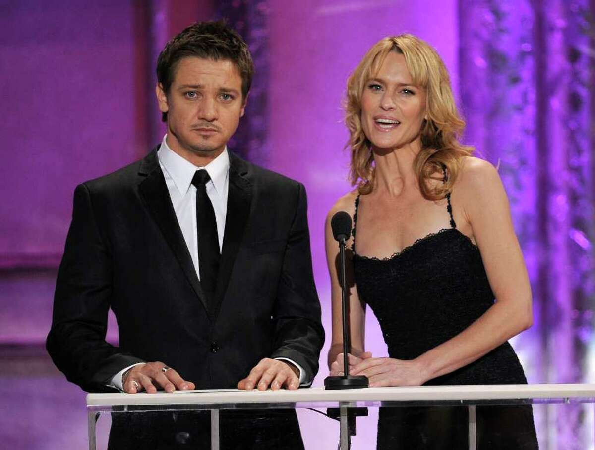 LOS ANGELES, CA - JANUARY 30: Actors Jeremy Renner (L) and Robin Wright speak onstage during the 17th Annual Screen Actors Guild Awards held at The Shrine Auditorium on January 30, 2011 in Los Angeles, California. (Photo by Kevin Winter/Getty Images) *** Local Caption *** Jeremy Renner;Robin Wright
