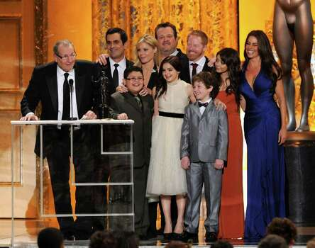 "LOS ANGELES, CA - JANUARY 30:  Cast of ""Modern Family,"" winners of Outstanding Performance by an Ensemble in a Comedy Series award, speak onstage during the 17th Annual Screen Actors Guild Awards held at The Shrine Auditorium on January 30, 2011 in Los Angeles, California.  (Photo by Kevin Winter/Getty Images) *** Local Caption *** Sofia Vergara;Jesse Tyler Ferguson;Julie Bowen Photo: Kevin Winter, Getty Images / 2011 Getty Images"