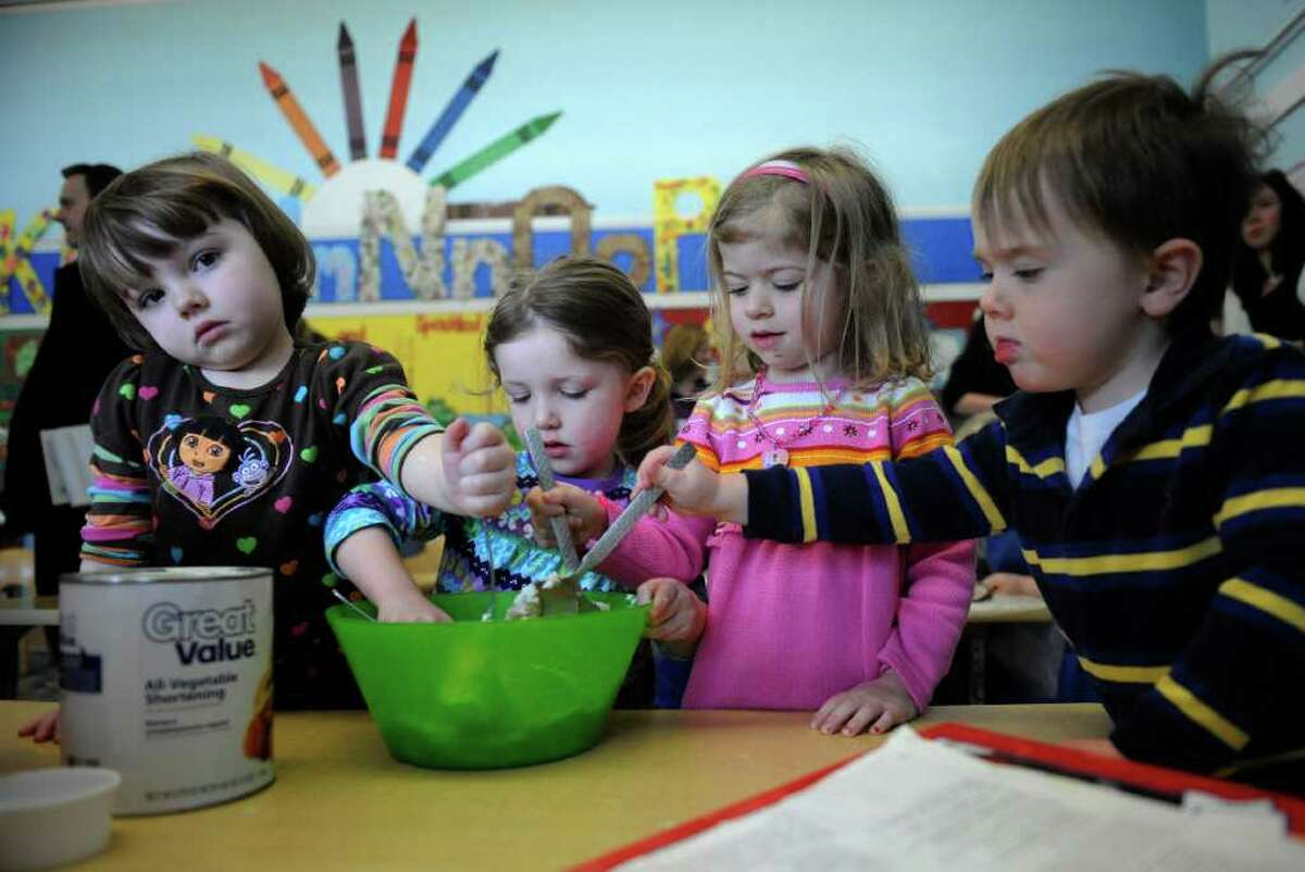 Students at the Bethlehem Preschool in Glenmont prepare some cookies during the announcement that the school was chosen to be part of a field test for the QUALITYstarsNY program January 27, 2011. The students from left; Lauren Dudgeon, Madilyn Broderick, Maya Richter and Jackson Valter. (Skip Dickstein / Times Union)