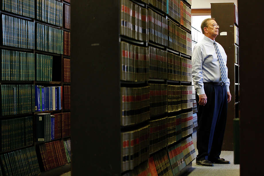Bexar County Law Library administrator Jimmy Allison stands among rows of bookshelves. The library is used by judges, attorneys and litigants. Photo: Jerry Lara/glara@express-news.net