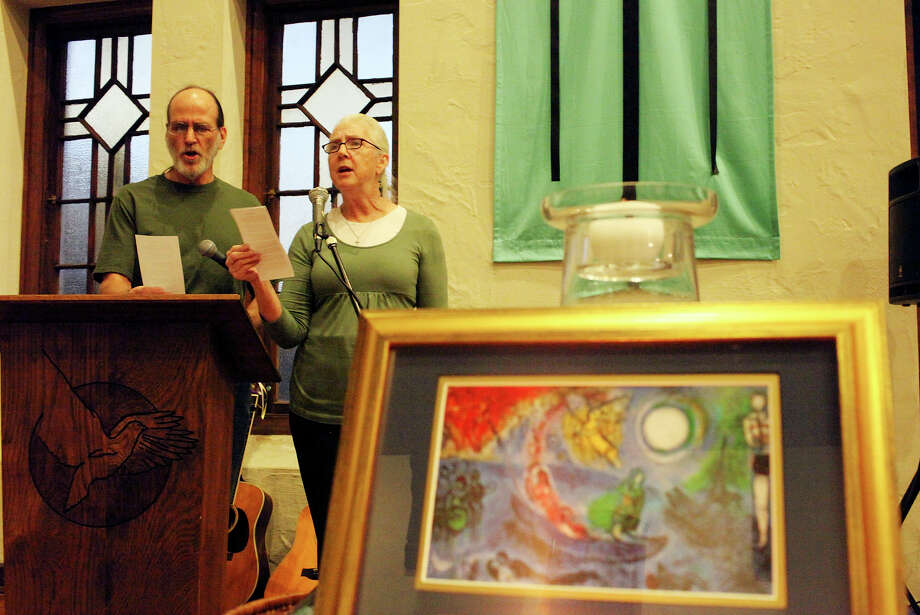 Rod and Patti Radle sing at the Blessing of the Peacemakers, where they were named San Antonio peace laureates. Photo: EDWARD A. ORNELAS/eaornelas@express-news.net