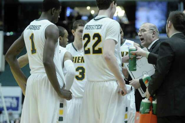 Siena coach Mitch Buonaguro, right, talks to his players during the second half of their 61-59 victory over Niagara on Sunday at Times Union Center in Albany.  (Paul Buckowski / Times Union) Photo: Paul Buckowski / 00011629C