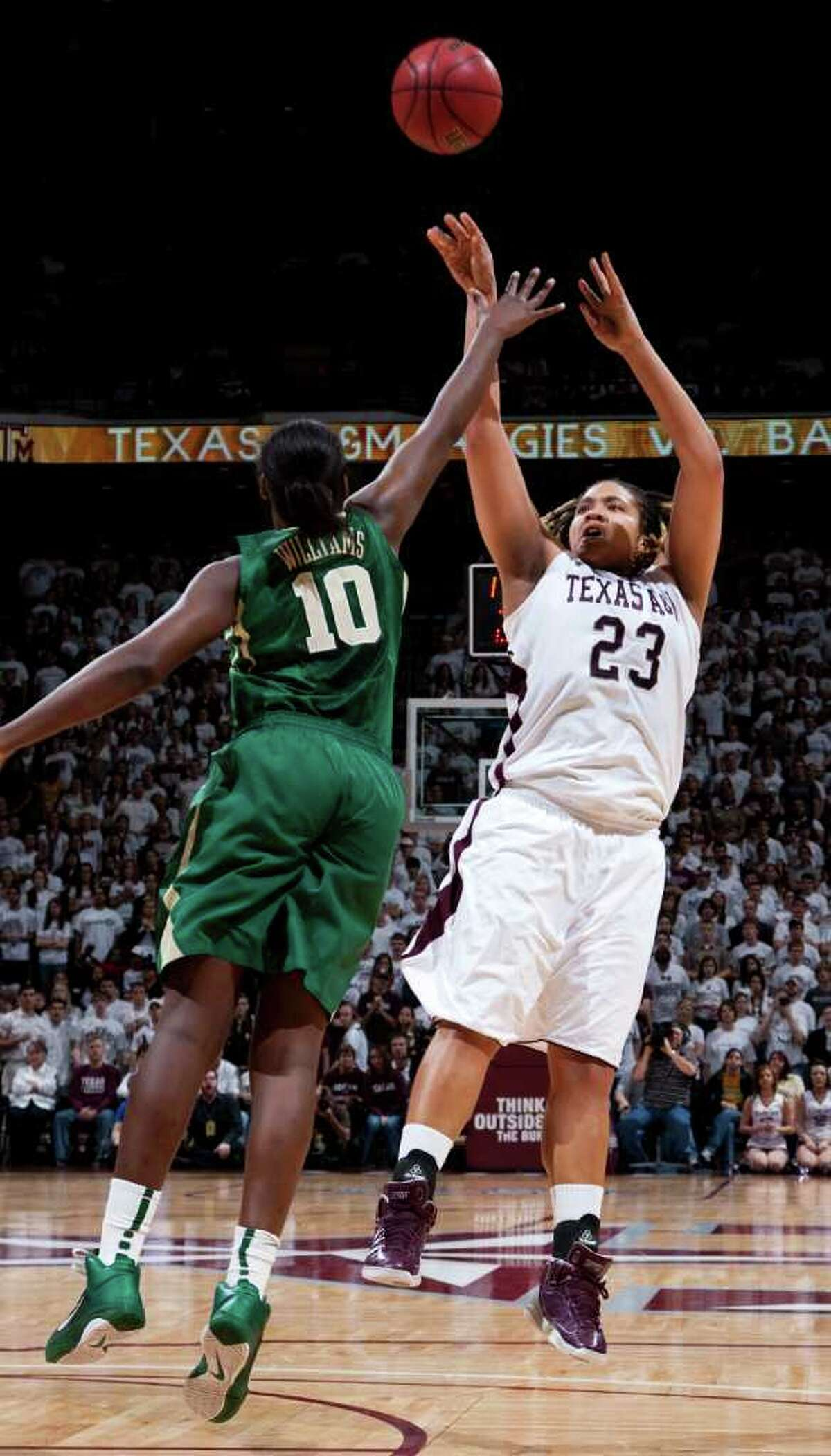 Texas A&M's Danielle Adams (right) shoots the ball over Baylor's Destiny Williams during the first half on Sunday, Jan. 30, 2011, in College Station.