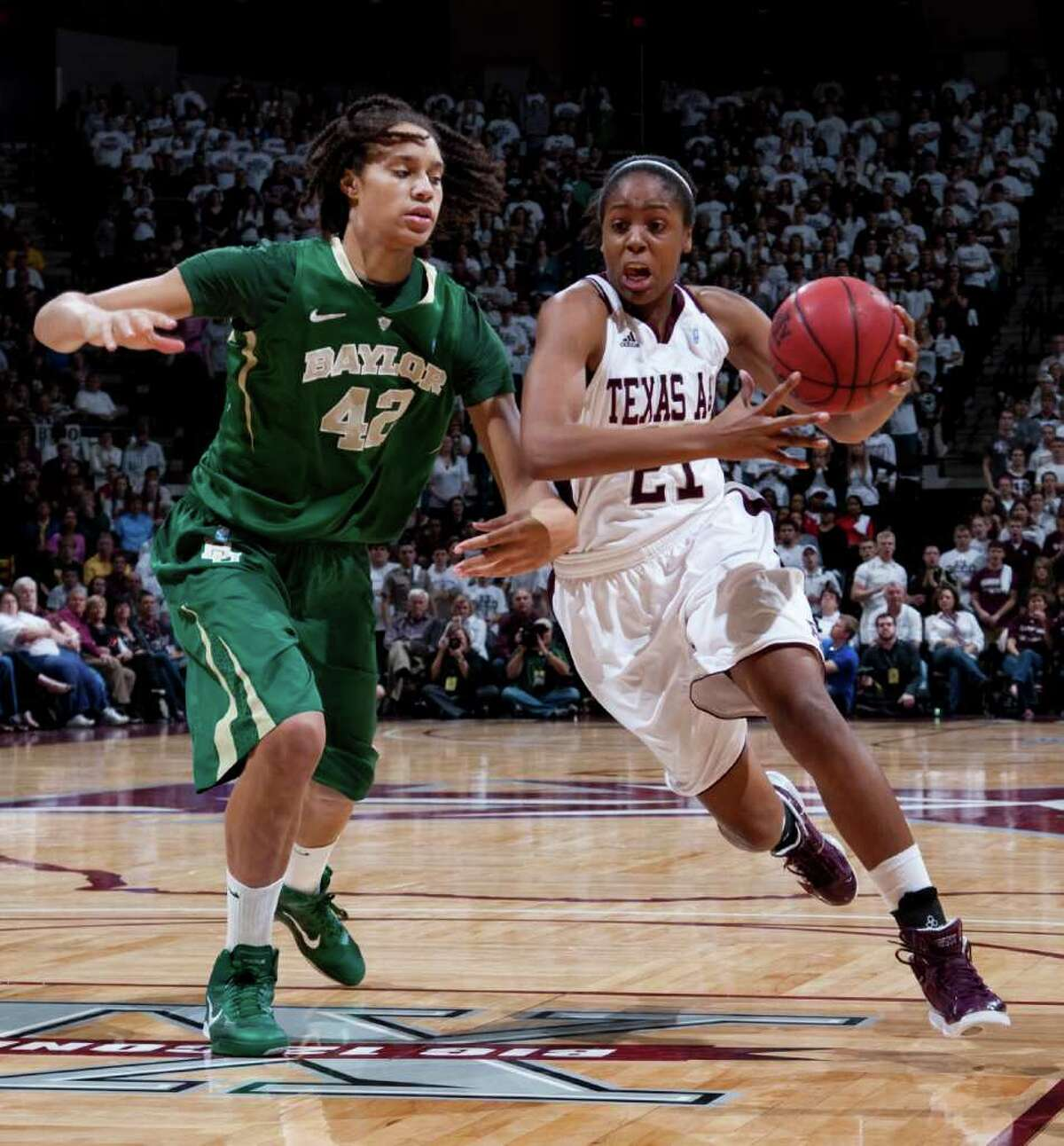Texas A&M forward Adaora Elonu drives the ball on Baylor's Brittney Griner during the first half on Sunday, Jan. 30, 2011, in College Station.
