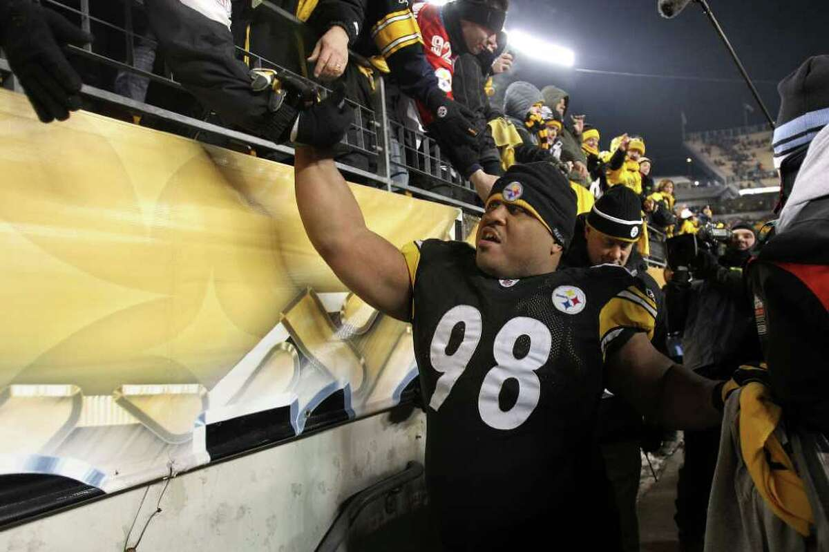Pittsburgh Steelers nose tackle Casey Hampton celebrates with fans after their 24-19 win over the New York Jets last Sunday in the AFC championship game. Hampton is pursuing his third Super Bowl ring with the team.